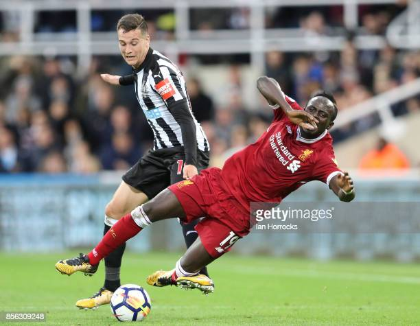 Javier Manquillo of Newcastle brings down Sadio Mane of Liverpool during the Premier League match between Newcastle United and Liverpool at St James...