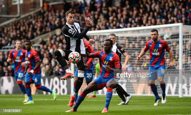 Javier Manquillo of Newcastle United FC and Tyrick Mitchell of Crystal Palace jostle for the ball during the Premier League match between Crystal...