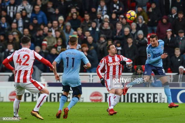 Javier Manquillo of Newcastle United heads the ball during the Premier League match between Stoke City and Newcastle United at Bet365 Stadium on...