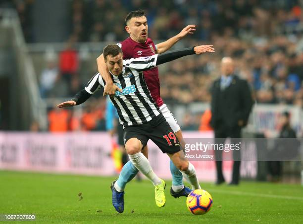 Javier Manquillo of Newcastle United is challenged by Robert Snodgrass of West Ham United during the Premier League match between Newcastle United...