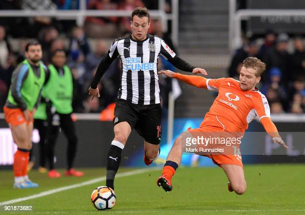 Javier Manquillo of Newcastle United is tackled by Luke Berry of Luton Town during the Emirates FA Cup Third Round match between Newcastle United and...