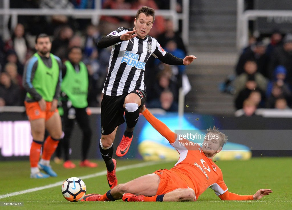 Javier Manquillo of Newcastle United is tackled by Luke Berry of Luton Town during the Emirates FA Cup Third Round match between Newcastle United and Luton Town at St James' Park on January 6, 2018 in Newcastle upon Tyne, England.