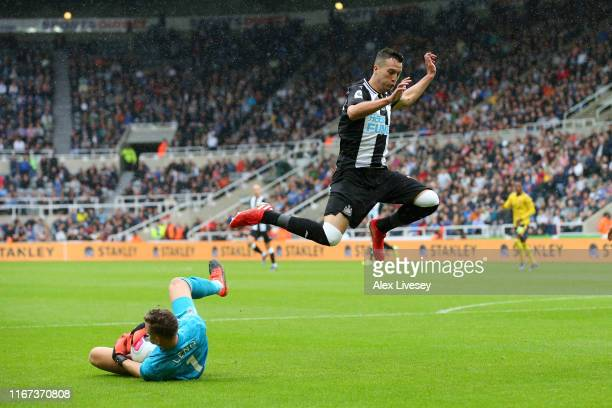 Javier Manquillo of Newcastle United jumps over Bernd Leno of Arsenal during the Premier League match between Newcastle United and Arsenal FC at St....