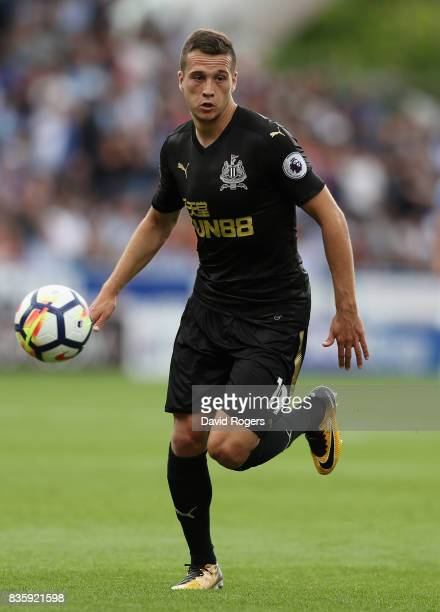 Javier Manquillo of Newcastle United runs with the ball during the Premier League match between Huddersfield Town and Newcastle United at John...