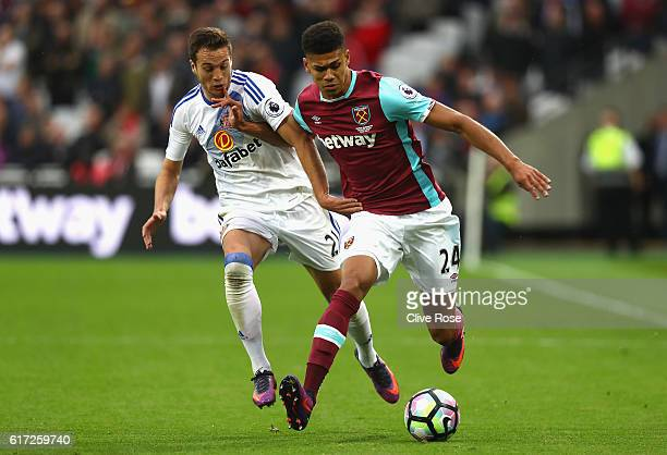 Javier Manquillo of Sunderland and Ashley Fletcher of West Ham United battle for possession during the Premier League match between West Ham United...