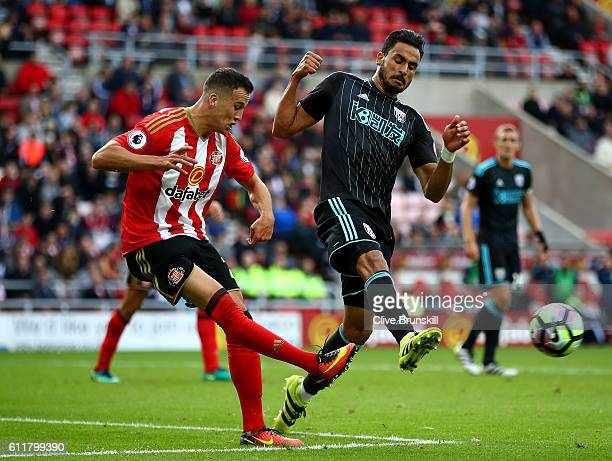 Javier Manquillo of Sunderland clears the ball while under pressure from Nacer Chadli of West Bromwich Albion during the Premier League match between...