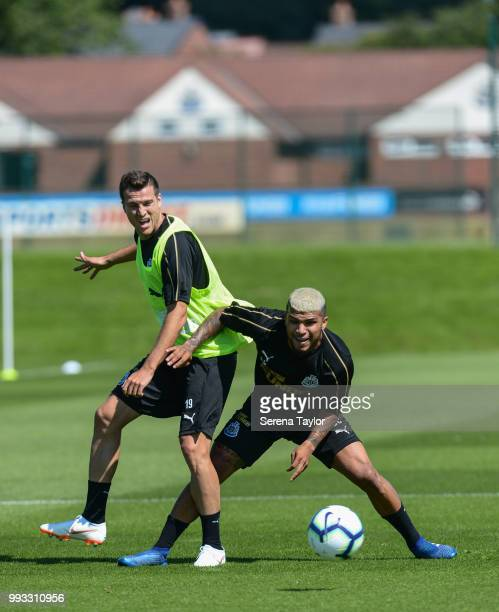 Javier Manquillo passes the ball before being tackled by DeAndre Yedlin during the Newcastle United Training Session at the Newcastle United Training...