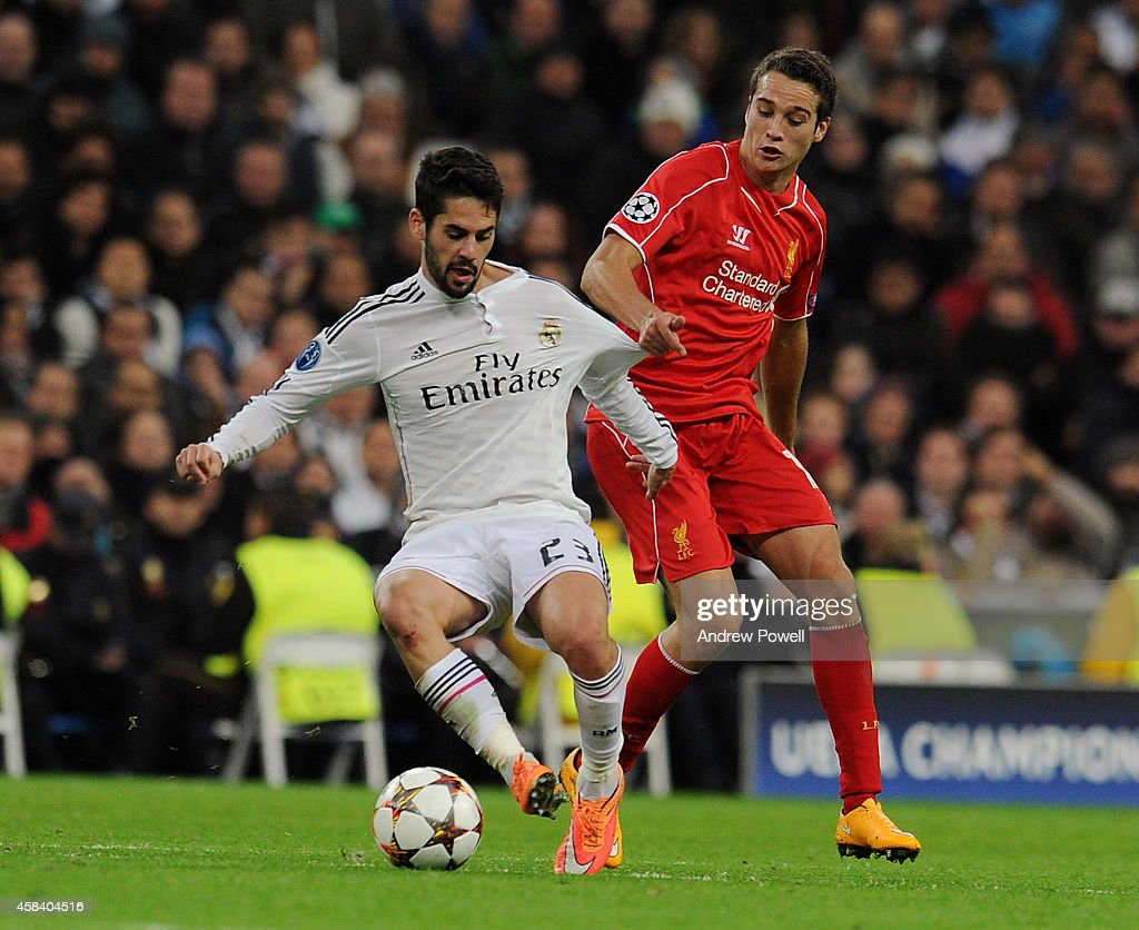 Javier Manquilo of Liverpool competes with Isco of Real Madrid CF during the UEFA Champions League match between Real Madrid CF and Liverpool FC on November 4, 2014 in Madrid, Spain.