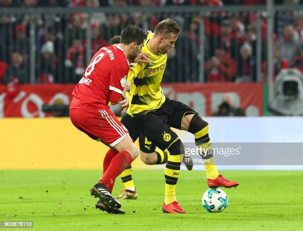 Javier Martinez Aginaga of Muenchen and Andrey Yarmolenko of Dortmund battle for the ball during the DFB Cup match between Bayern Muenchen and...