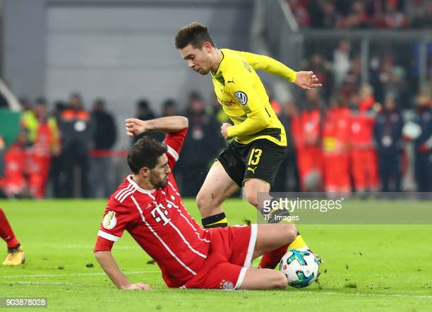 Javier Martinez Aginaga of Muenchen and Raphael Guerreiro of Dortmund battle for the ball during the DFB Cup match between Bayern Muenchen and...