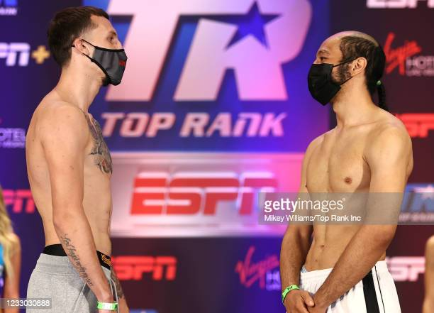 Javier Martinez and Calvin Metcalf face-off during the weigh-in at Virgin Hotels Las Vegas on May 21, 2021 in Las Vegas, Nevada.