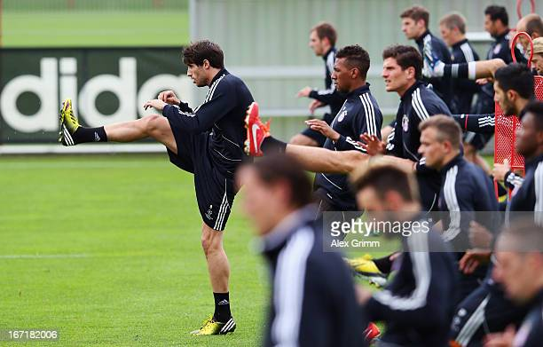 Javier Martinez and team mates exercise during a Bayern Muenchen training session ahead of their UEFA Champions League Semi Final first leg match...