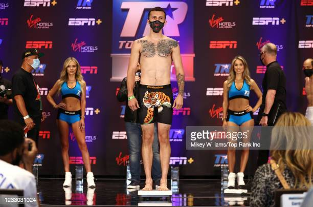 Javier Martinez flexes on the scale ahead of his fight with Calvin Metcalf( at Virgin Hotels Las Vegas on May 21, 2021 in Las Vegas, Nevada.