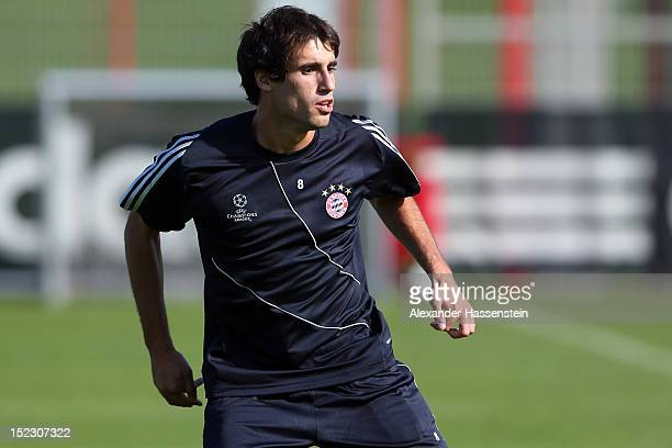 Javier Martinez looks on during a FC Bayern Muenchen training session ahead of their UEFA Champions League group F match against Valencia CF at the...