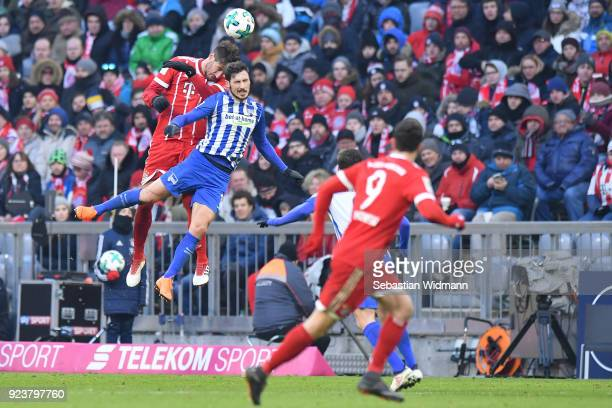 Javier Martinez of Bayern Muenchen and Mathewe Leckie of Berlin jump for a header during the Bundesliga match between FC Bayern Muenchen and Hertha...