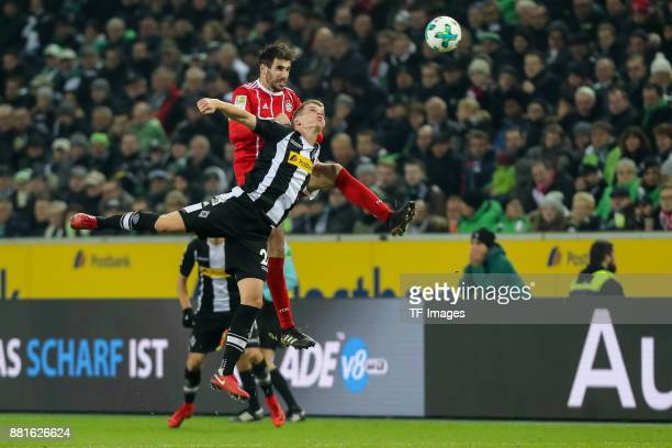 Javier Martinez of Bayern Muenchen and Matthias Ginter of Borussia Moenchengladbach battle for the ball during the Bundesliga match between Borussia...