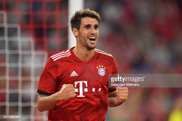 Javier Martinez of Bayern Muenchen celebrates scoring his teams first goal during the friendly match between Bayern Muenchen and Manchester United at...
