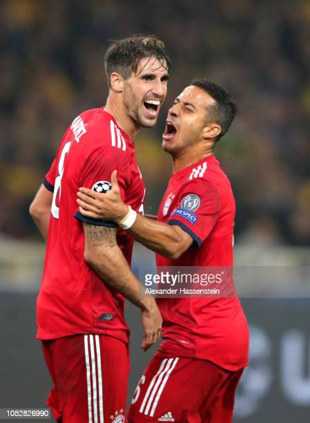 Javier Martinez of Bayern Munich celebrates after scoring his team's first goal with Thiago Alcantara during the Group E match of the UEFA Champions...