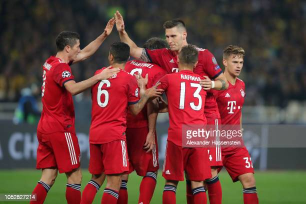 Javier Martinez of Bayern Munich celebrates with teammates after scoring his team's first goal during the Group E match of the UEFA Champions League...