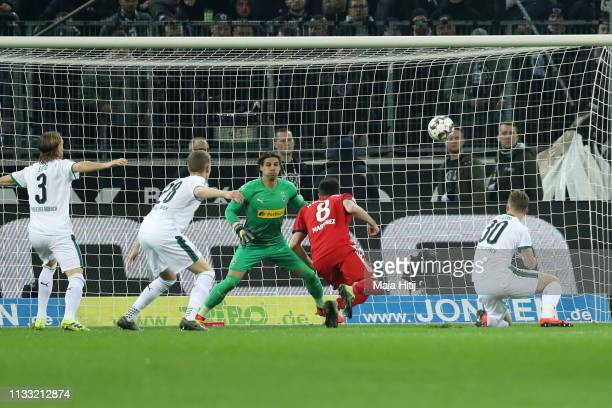 Javier Martinez of Bayern Munich scores his team's first goal during the Bundesliga match between Borussia Moenchengladbach and FC Bayern Muenchen at...