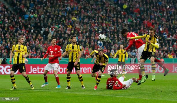 Javier Martinez of FC Bayern Muenchen after he heads the equalizing goal during the DFB Cup semi final match between FC Bayern Muenchen and Borussia...