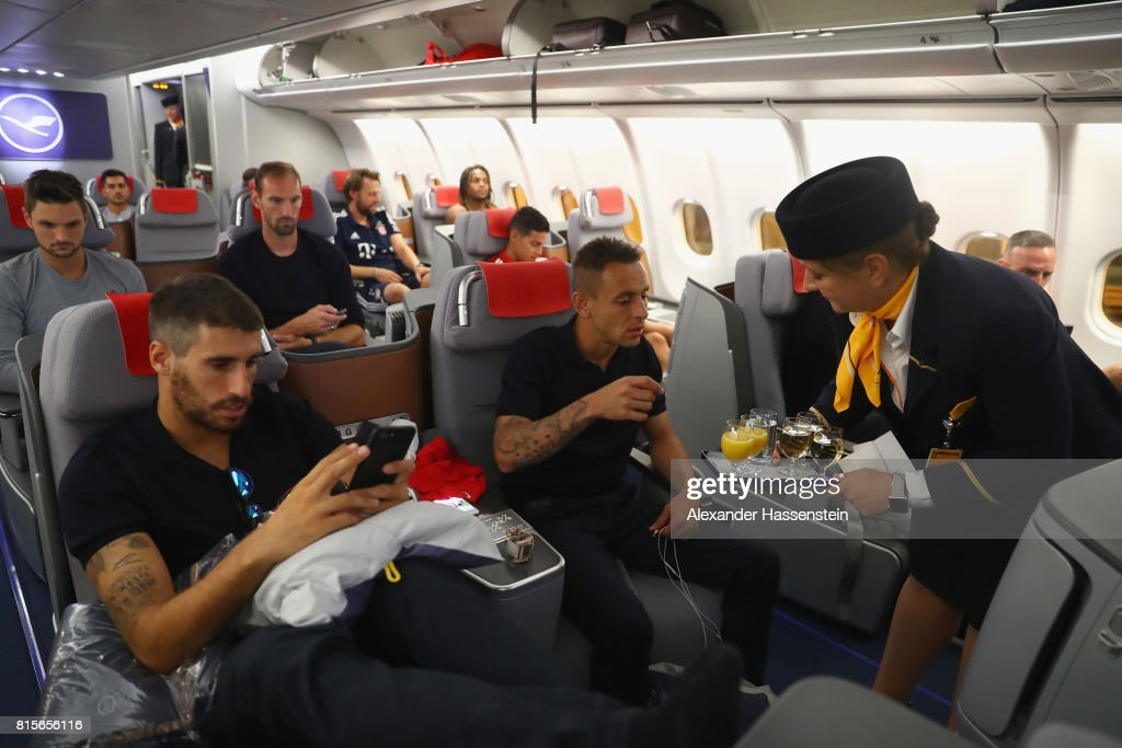 Javier Martinez (L) of FC Bayern Muenchen and his team mate Rafinha on board on the team flight to Shanghai for the FC Bayern Muenchen Pre-Season Tour on July 16, 2017 in Munich, Germany.