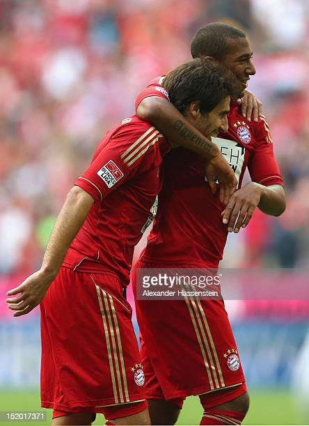Javier Martinez of Muenchen celebrates the 3rd team goal with his team mate Jerome Boateng during the Bundesliga match between FC Bayern Muenchen and...