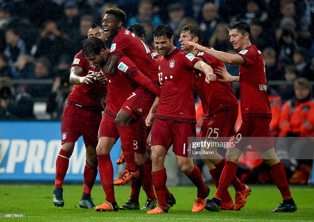 Javier Martinez of Muenchen celebrates with team mates after scoring his teams second goal during the Bundesliga match between FC Schalke 04 and FC Bayern Muenchen at Veltins-Arena on November 21, 2015 in Gelsenkirchen, Germany.