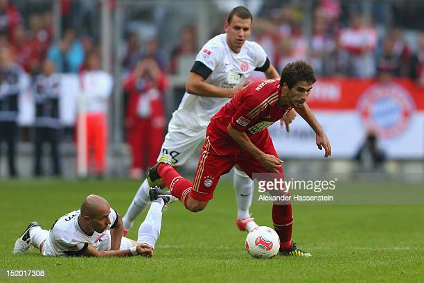 Javier Martinez of Muenchen is challenged by Elkin Soto of Mainz and his team mate Adam Szala during the Bundesliga match between FC Bayern Muenchen...