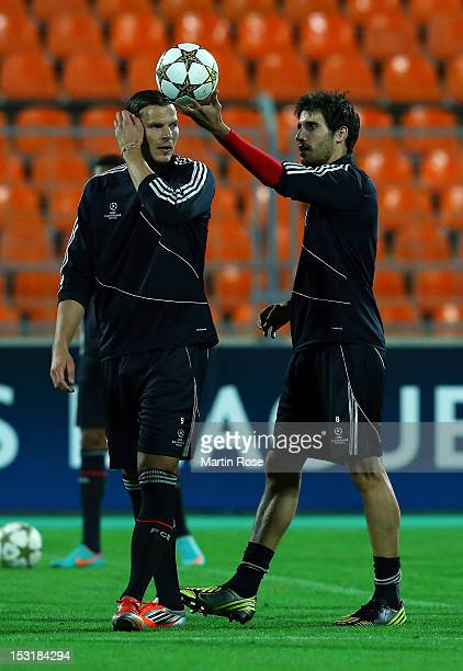 Javier Martinez of Muenchen jokes with team mate Daniel van Buyten during a FC Bayern Muenchen training session ahead of their UEFA Champions League...