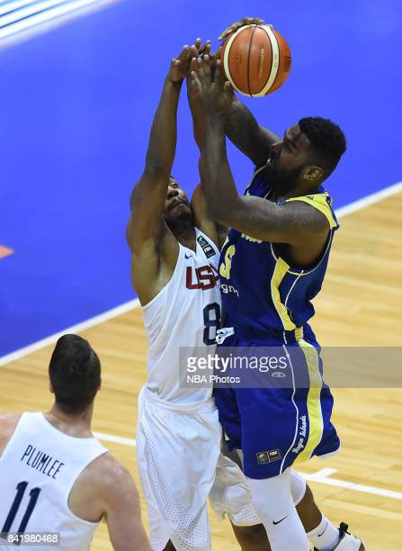 Javier Martinez of Virgin Islands fights for the ball with Wendell Williams Jr of United States during the FIBA Americup semi final match between US...