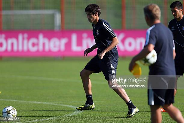 Javier Martinez plays with the ball during a FC Bayern Muenchen training session ahead of their UEFA Champions League group F match against Valencia...