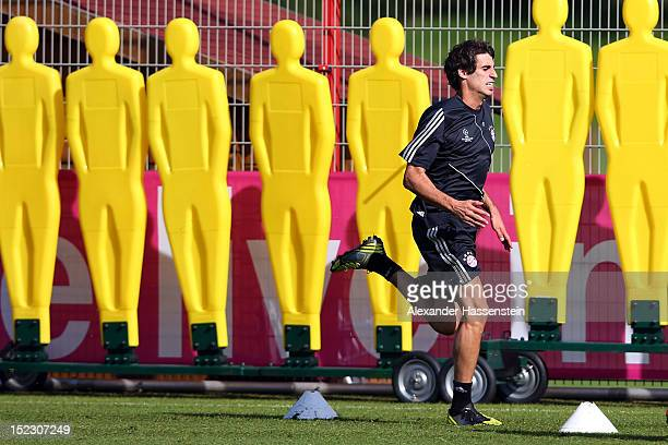 Javier Martinez runs during a FC Bayern Muenchen training session ahead of their UEFA Champions League group F match against Valencia CF at the...