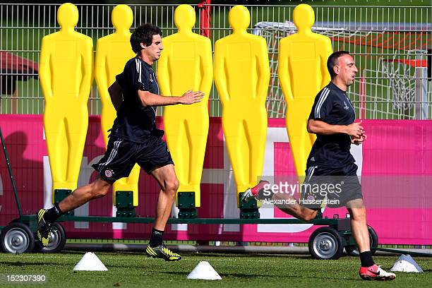 Javier Martinez runs with his team mate Franck Ribery during a FC Bayern Muenchen training session ahead of their UEFA Champions League group F match...