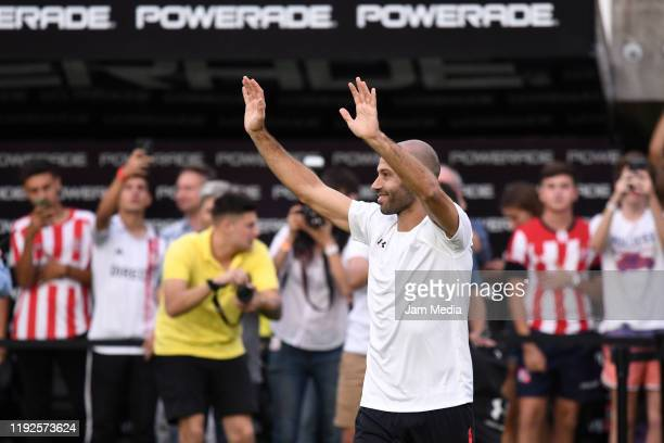 Javier Mascheran waves at fans during his presentation as new player of Estudiantes de La Plata at Jorge Luis Hirschi Stadium on December 7 2019 in...