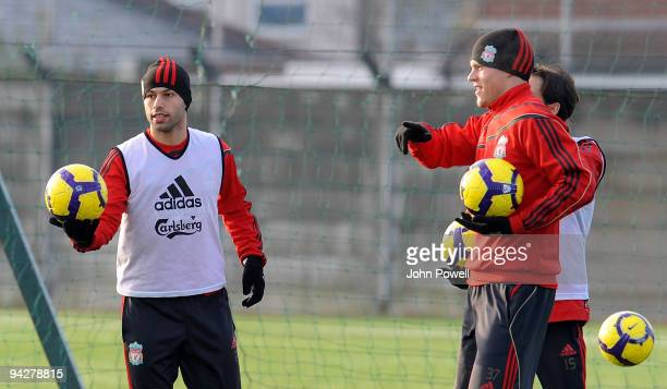 Javier Mascherano and Martin Skrtel take part in a team training session at Melwood training ground on December 11 2009 in Liverpool England