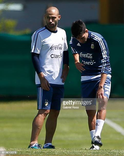 Javier Mascherano and Nicolas Gaitan of Argentina talk during a training session at Argentine Football Association 'Julio Humberto Grondona' training...