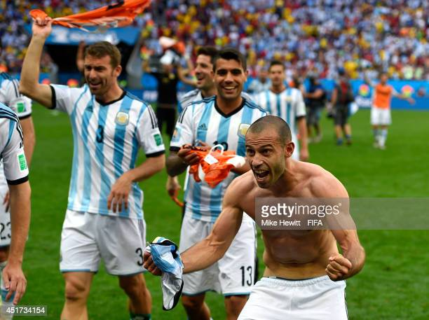 Javier Mascherano and players of Argentina celebate the 1-0 win after the 2014 FIFA World Cup Brazil Quarter Final match between Argentina and...