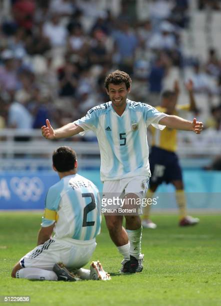 Javier Mascherano and Roberto Ayala of Argentina celebrate winning the Gold medal after beating Paraguay 10 in the men's football gold medal match...