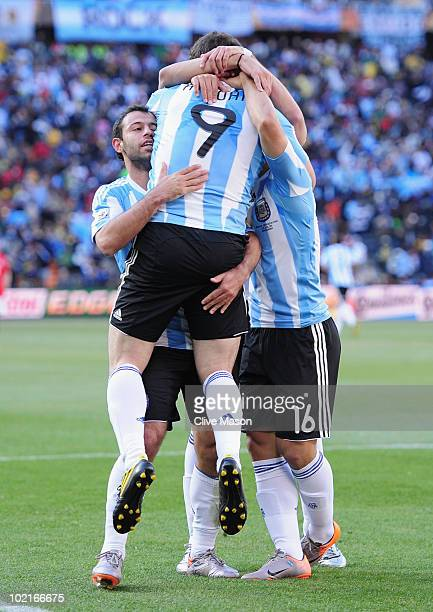 Javier Mascherano and Sergio Aguero of Argentina celebrate the third goal by Gonzalo Higuain of Argentina during the 2010 FIFA World Cup South Africa...