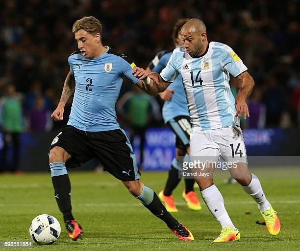 Javier Mascherano of Argentina and Jose Gimenez of Uruguay battle for the ball during a match between Argentina and Uruguay as part of FIFA 2018...