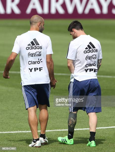 Javier Mascherano of Argentina and Lionel Messi of Argentina talk during a training session at Stadium of Syroyezhkin sports school on June 24 2018...