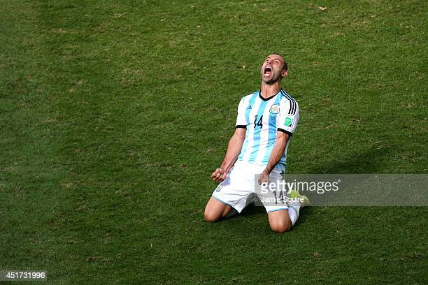 Javier Mascherano of Argentina celebrates after defeating Belgium 1-0 during the 2014 FIFA World Cup Brazil Quarter Final match between Argentina and...