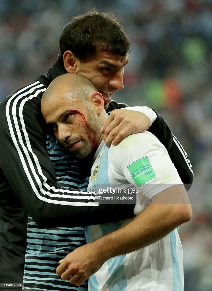 Javier Mascherano of Argentina celebrates victory with Nahuel Guzman following the 2018 FIFA World Cup Russia group D match between Nigeria and Argentina at Saint Petersburg Stadium on June 26, 2018 in Saint Petersburg, Russia.