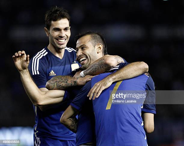 Javier Mascherano of Argentina celebrates with Jos Basanta and ngel Di Mara after scoring his team's second goal during a FIFA friendly match between...