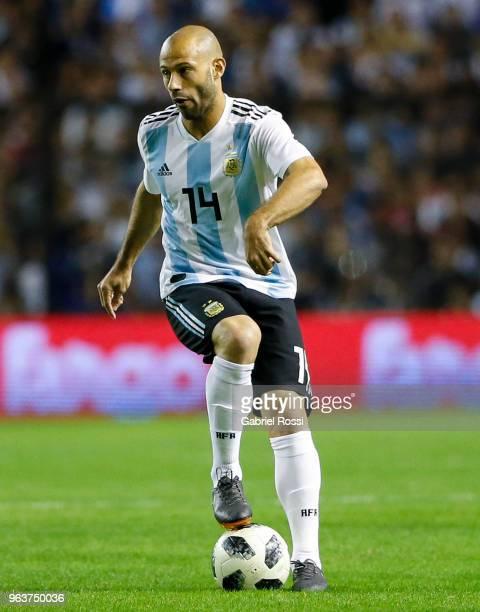 Javier Mascherano of Argentina controls the ball during an international friendly match between Argentina and Haiti at Alberto J Armando Stadium on...