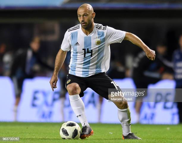 Javier Mascherano of Argentina drives the ball during an international friendly match between Argentina and Haiti at Alberto J Armando Stadium on May...