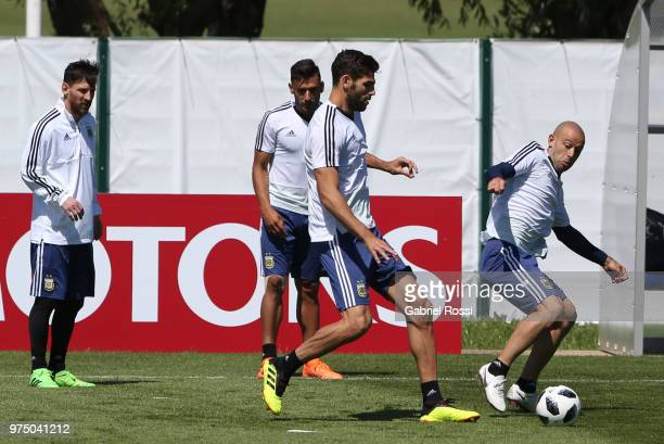 Javier Mascherano of Argentina fights for the ball with Federico Fazio of Argentina during the last training session before their first game of the...