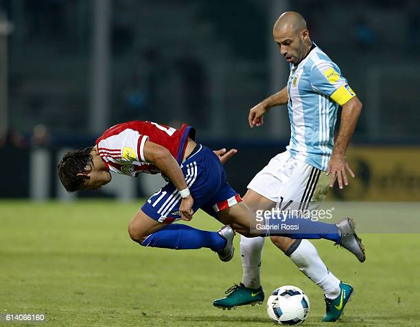 Javier Mascherano of Argentina fights for the ball with Oscar Romero of Paraguay during a match between Argentina and Paraguay as part of FIFA 2018...