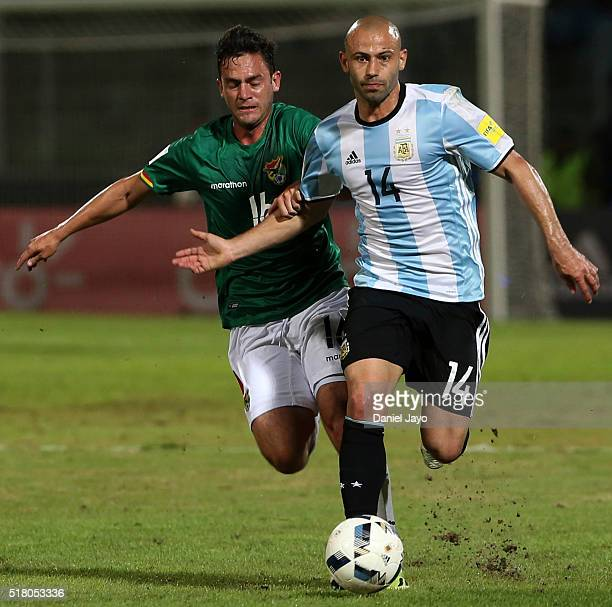Javier Mascherano of Argentina is chased by Fernando Saucedo of Bolivia during a match between Argentina and Bolivia as part of FIFA 2018 World Cup...